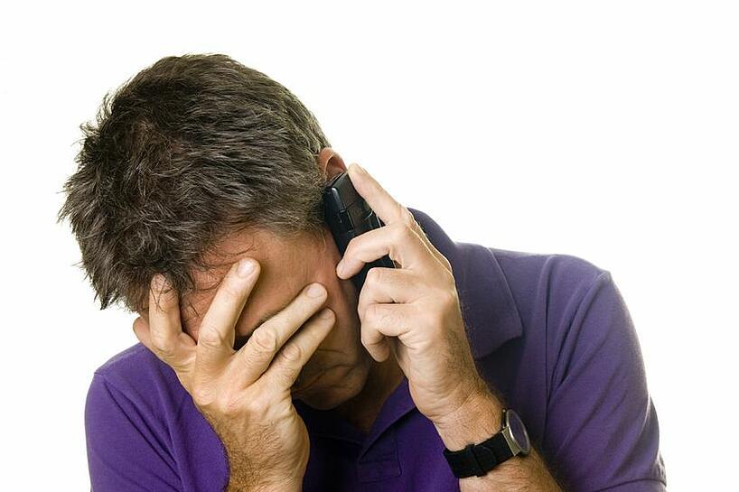Sad man on phone.jpg